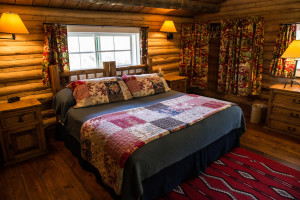 The queen bedroom at Dining Cabin 6 | Dubois Wyoming Lodging | CM Ranch