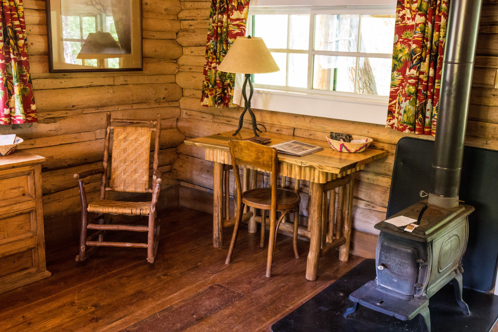Wood-fired stove and desk in the bedroom at Dining Cabin 6 | Dubois Wyoming Lodging | CM Ranch