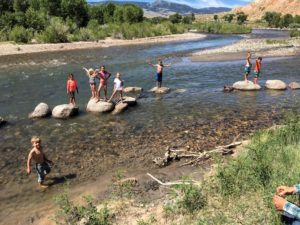 Family plays in the river at CM Ranch in Dubois, WY | Dude Ranch Wyoming Family