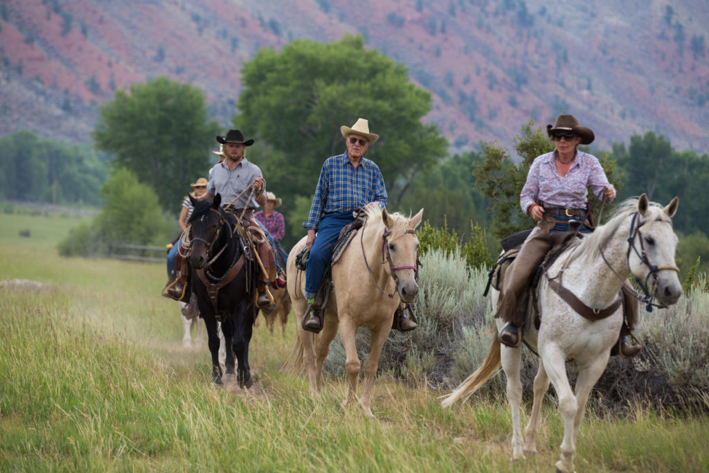 A CM Ranch guide takes guests on horseback out for a trail ride in the mountains near CM Ranch in Dubois, WY | Horseback Riding Jackson Hole