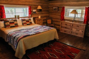 Queen bed, dresser and chair in Dining Cabin 4 | Dude Ranch Near Yellowstone | CM Ranch
