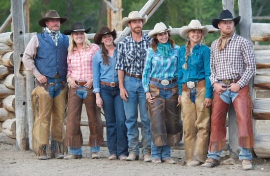 A group of employees in chaps, cowboy boots and hats at CM Ranch in Dubois, WY | Wyoming dude ranch