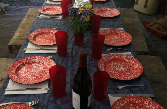 A table is set for dinner on a pack trip horseback riding in Wyoming near CM Ranch