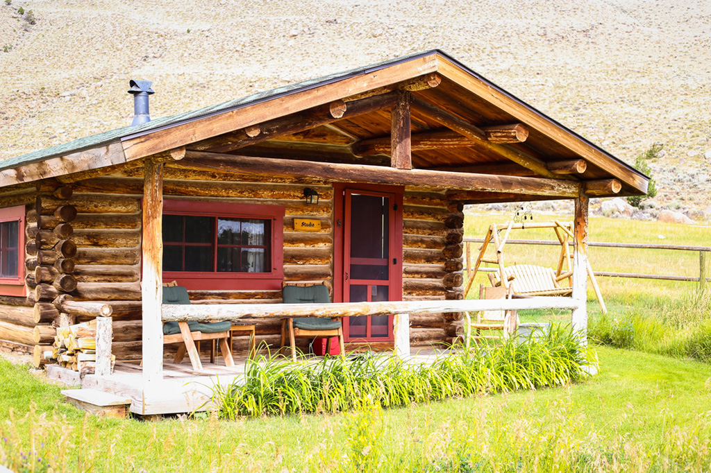Studio Cabin Exterior | Horseback riding vacation packages at CM Ranch