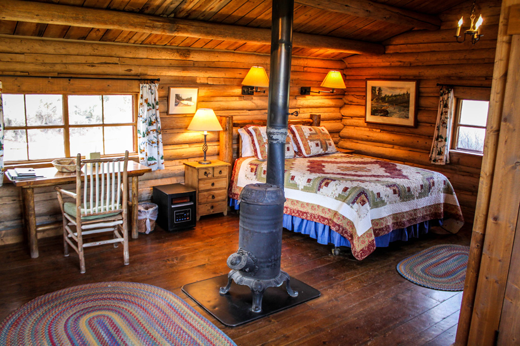 Studio Cabin Bedroom | Horseback riding vacation packages at CM Ranch