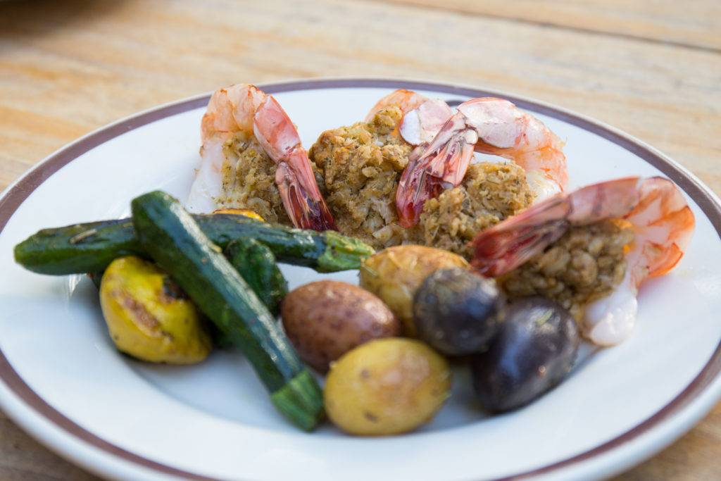A plated dinner of country-fried shrimp, potatoes and zucchini at CM Ranch in Dubois, WY | Wyoming dude ranches for families