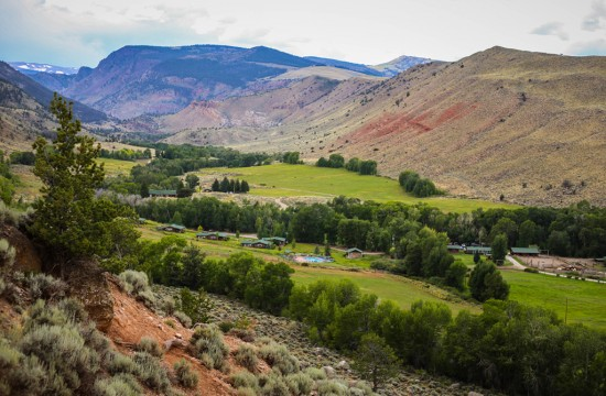 A view of the ranch building from a hill above at CM Ranch in Dubois, WY | Jackson Hole Wyoming horseback riding